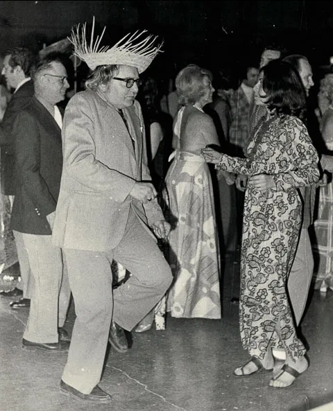 The author's father dancing in straw hat, 1980
